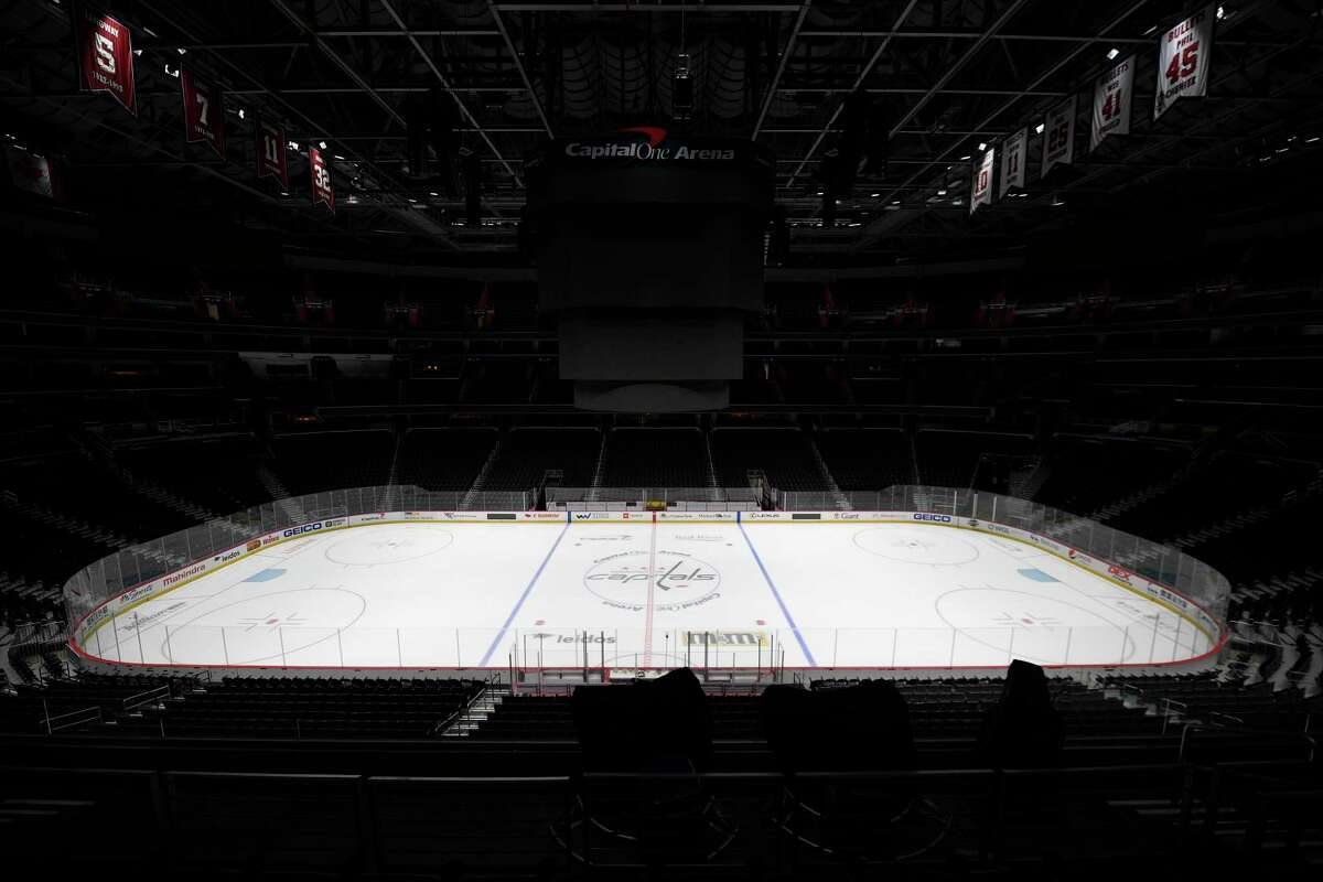 The Capital One Arena, home of the Washington Capitals NHL hockey club, sits empty Thursday, March 12, 2020, in Washington. The NHL is following the NBAa€™s lead and suspending its season amid the coronavirus outbreak, the league announced Thursday. (AP Photo/Nick Wass)
