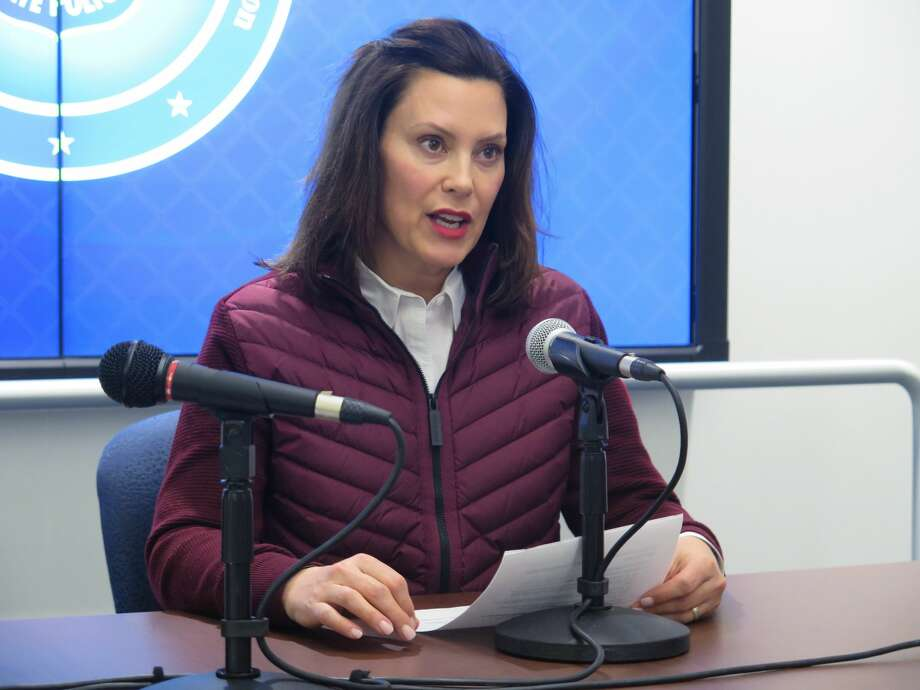 FILE - In this Tuesday, March 10, 2020, file photo, Michigan Gov. Gretchen Whitmer announces the state's first two cases of coronavirus, at the Michigan State Police headquarters in Windsor Township, Mich. Coronavirus cases in Michigan rose sharply late Thursday, March 12, 2020, as officials announced more cases, and as some K-12 schools began announcing closures while others began training staff to potentially move to online learning only. (AP Photo/David Eggert, File) Photo: (AP Photo/David Eggert, File) / Copyright 2020 The Associated Press. All rights reserved