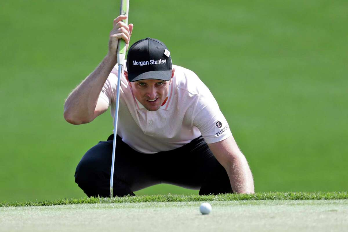 Justin Rose, of England, studies his shot on the third green during the first round of The Players Championship golf tournament, Thursday, March 12, 2020, in Ponte Vedra Beach, Fla. (AP Photo/Lynne Sladky)