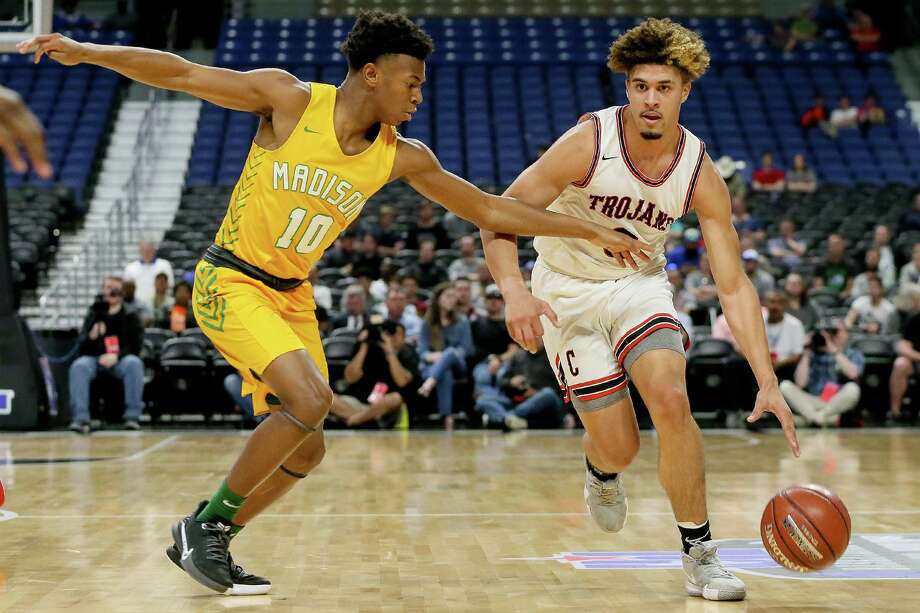 Coldspring-Oakhurst's Jacoby Bishop (right) brings the ball upcourt against Dallas Madison's Christian Henry (10) during the first half of their Class 3A state semifinal basketball game at the Alamodome in San Antonio on Thursday, March 12, 2020. Photo: Marvin Pfeiffer / For The Chronicle / © 2020 Houston Chronicle