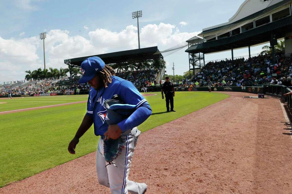 Toronto Blue Jays third baseman Vladimir Guerrero Jr. walks off the field during a spring training baseball game against the Pittsburgh Pirates, Thursday, March 12, 2020, in Bradenton, Fla. (AP Photo/Carlos Osorio)
