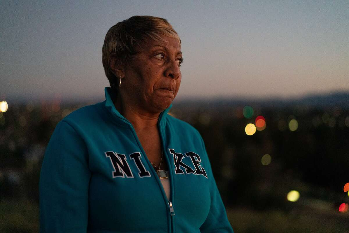 Sylvia Lewis works during the events at Chase and other venues and will lose all her income. She stand on a hill behind her home wondering how she�ll pay for the mortgage on Thursday, March 12, 2020, in Antioch, Calif.
