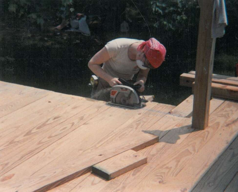 Margie Miller working on a deck as a self-employed carpenter in 1991. (Photo provided)
