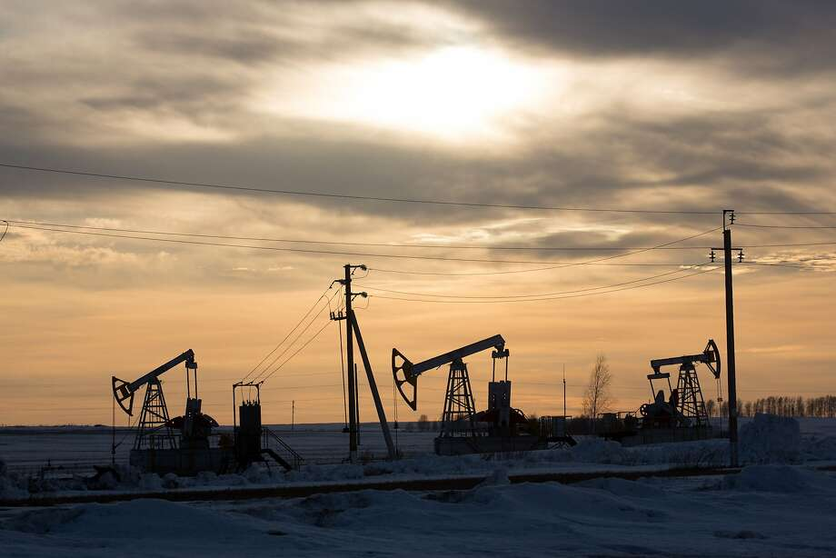 "Oil pumping jacks, also known as ""nodding donkeys"", operate in an oilfield near Almetyevsk, Tatarstan, Russia, on Wednesday, March 11, 2020. Photo: Andrey Rudakov, Bloomberg"