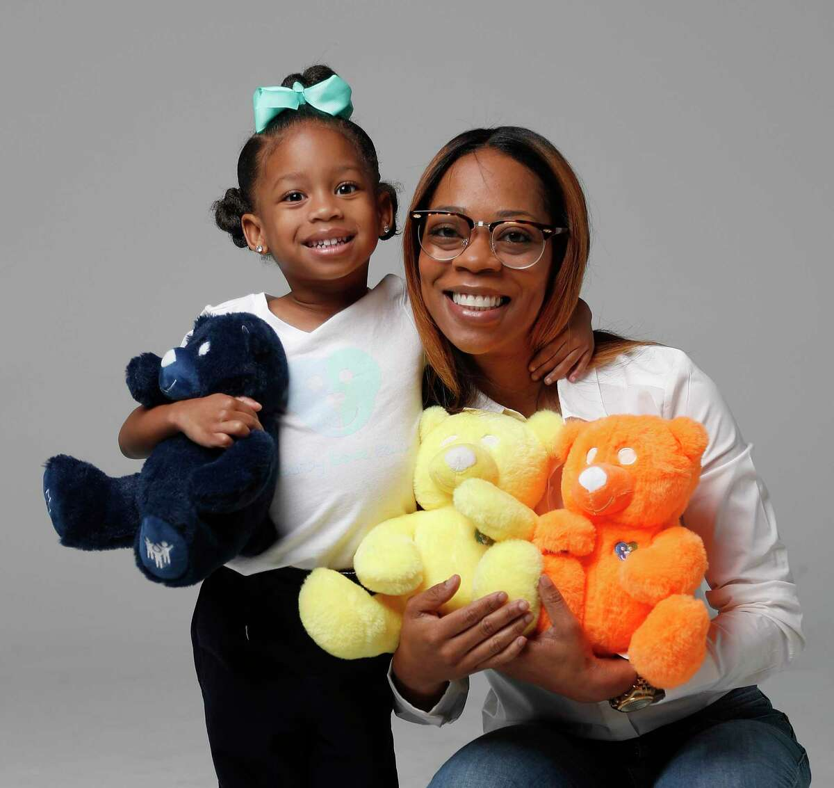 """Tameka Maiden's daughter, Tori Thomas, 4, holds U'Neek - the Gifted Bear. Maiden is looking to partner with businesses on a """"Get a Bear, Give a Bear"""" campaign to donate the bear to needy nonverbal children with autism."""
