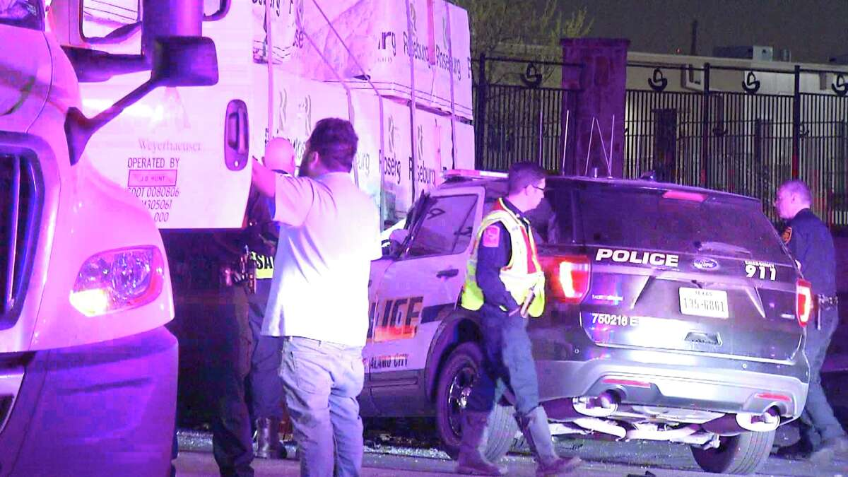 A San Antonio police officer was hospitalized early Friday morning after crashing into a semi-truck near the AT&T Center.