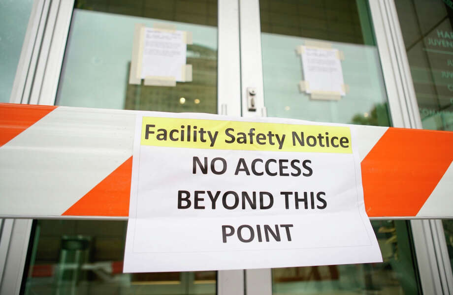 The doors are blocked and signs are up on the doors of the Harris County Juvenile Justice Center Friday, March 13, 2020, in downtown Houston. Photo: Mark Mulligan/Staff Photographer / 2020
