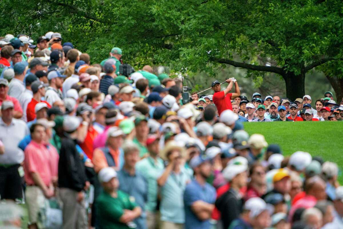 Tiger Woods hits from the fourth tee during the final round of the Masters in Augusta, Ga., April 14, 2019. He captured his fifth Masters title and his 15th major tournament on Sunday, snapping a championship drought of nearly 11 years. (Doug Mills/The New York Times)