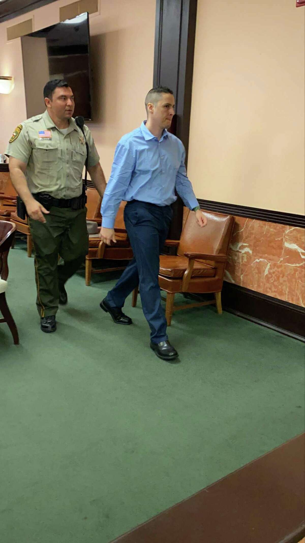 Ronald Anthony Burgos-Aviles left the 49th District Court Thursday after his third motion to remove his counsel was denied.