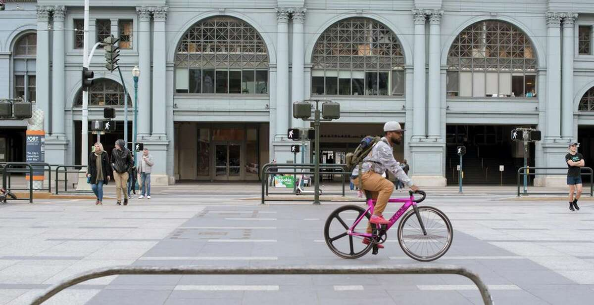 San Francisco sidewalks are largely empty as many companies urge employees to work from home during the coronavirus outbreak.