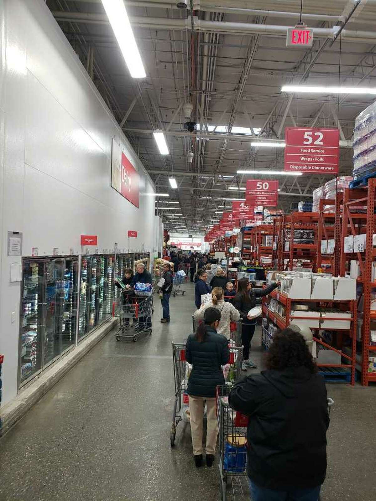 The checkout line at BJs extended to the produce section on Friday, March 13, 2020. None the less, the line moved fast. One shopper's cart was filled with two beef roasts, three dozen eggs and at five large bottles of liquor (from the BJs liquor store) .