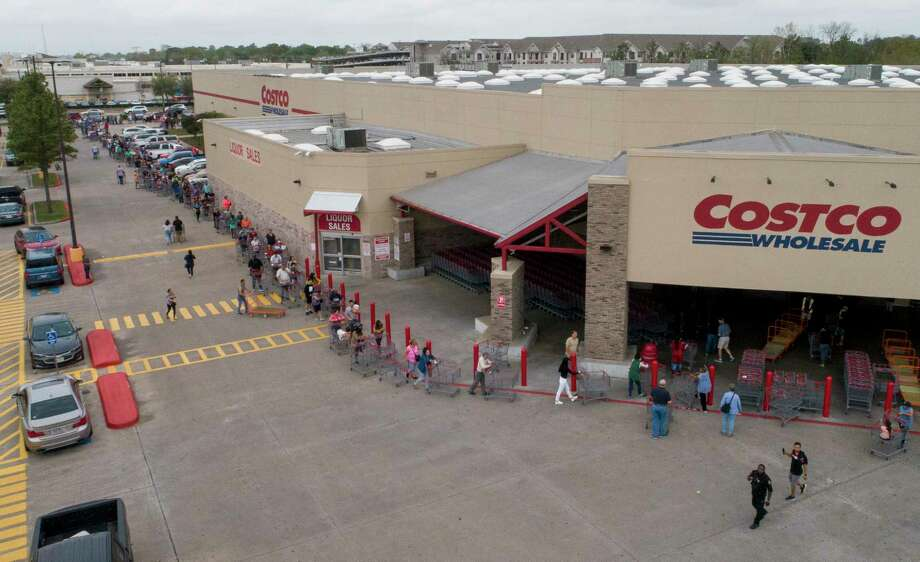 People wait in line for the Costco Wholesale at Bunker Hill Road to open Friday, March 13, 2020, in Houston. People are rushing to grocery stores amid fears of the new coronavirus pandemic. Photo: Godofredo A. Vásquez, Staff Photographer / © 2020 Houston Chronicle
