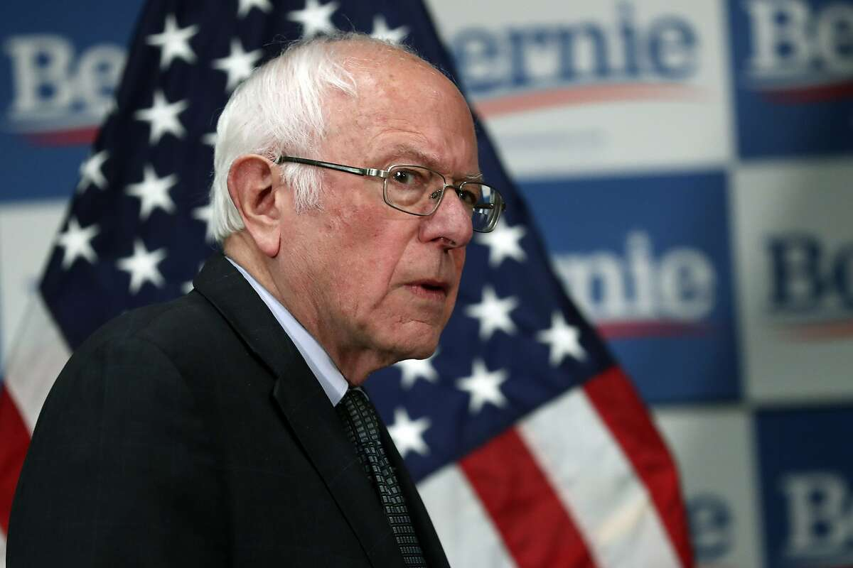 Democratic presidential candidate, Sen. Bernie Sanders, I-Vt., arrives to speak to reporters about the coronavirus Thursday March 12, 2020, in Burlington, Vt. (AP Photo/Charles Krupa)