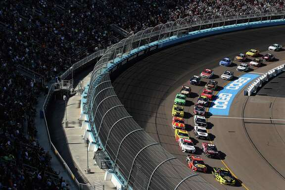 Brad Keselowski, driver of the #2 Alliance Parts Ford, leads the pack during the NASCAR Cup Series FanShield 500 at Phoenix Raceway on March 8, 2020 in Avondale, Ariz. The next two NASCAR races at Atlanta and Homestead-Miami will run without fans to prevent the spread of coronavirus, NASCAR announced Thursday.
