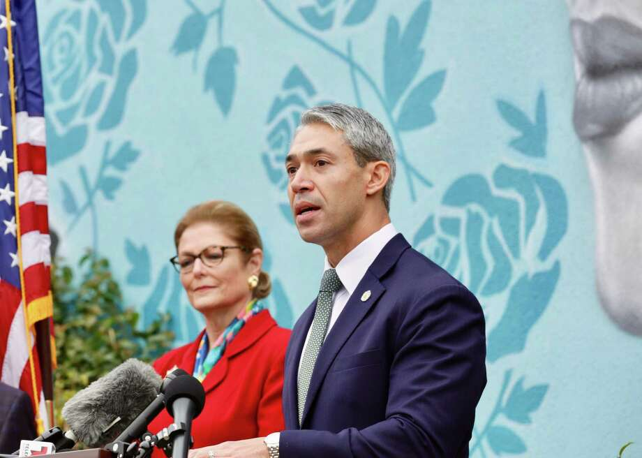 Mayor Ron Nirenberg and Jeanie Travis, the president of the Fiesta San Antonio Commission announce Fiesta will be held in November during a news conference Friday, March 13. Photo: Bob Owen /San Antonio Express-News / San Antonio Express-News
