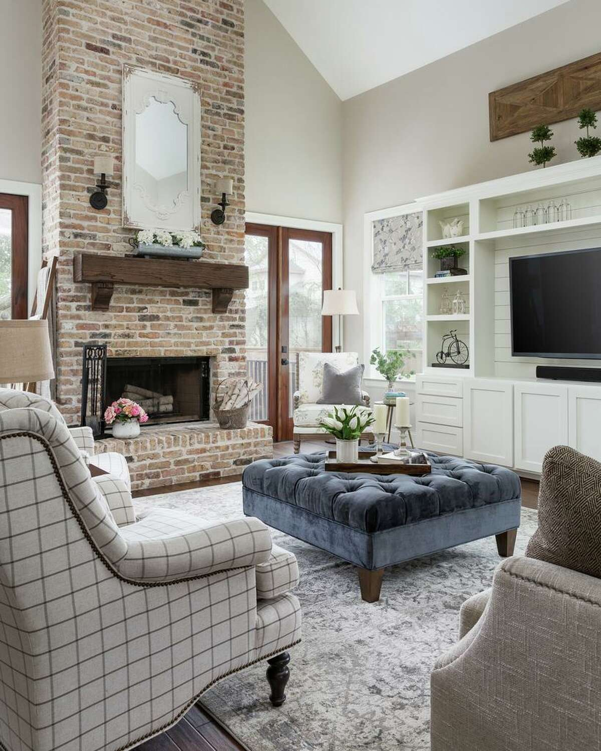 An upholstered ottoman serves as a coffee table in the Richards' family room.