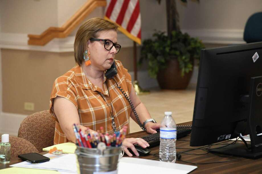 Lorena Meza takes calls and questions from concerned parents and the community about the coronavirus and the UISD protocols Thursday. Photo: Christian Alejandro Ocampo /Laredo Morning Times / Laredo Morning Times