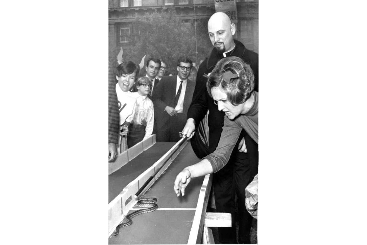 Anton LaVey, Mrs. Eddie Dove and P.V. Wriggle at the San Francisco St. Patrick's Day snake race. March 17, 1968