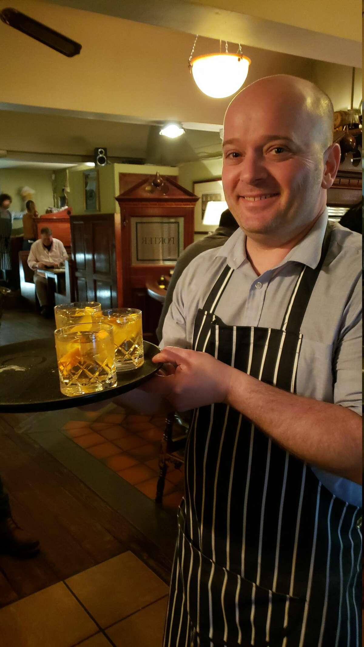 A round of Irish whiskey-based Old Fashioneds is delivered by the barman at L. Mulligan Grocer. Enjoy a cocktail in the downstairs pub, then head upstairs for dinner. The menu changes frequently to reflect the local seasons, but Scotch eggs are always available and complimentary chips are offered at the end of the meal To-Go.
