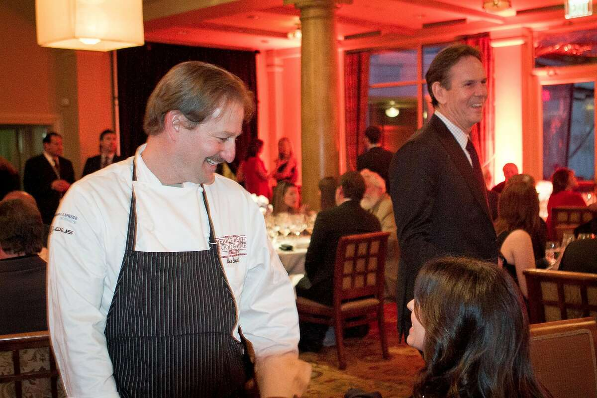 """Chef Thomas Keller with Chef Ron Siegel during the """"Tribute to Thomas Keller"""" dinner at the Pebble Beach Food and Wine event in Pebble Beach, Calif. is seen on Friday April 13h, 2012."""