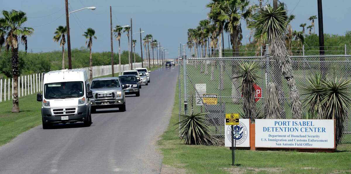 FILE - In this June 26, 2018, file photo, vehicles leave the Port Isabel Detention Center, which holds detainees of the U.S. Immigration and Customs Enforcement in Los Fresnos, Texas. Immigration officials say a 24-year-old woman delivered a stillborn baby while in custody last week. They say the Honduran woman was about six months pregnant when she went into premature labor and delivered a stillborn boy on Friday, Feb.22, 2019 after having been hospitalized but cleared for release a day earlier. She had spent four days in immigration custody. In a joint statement, U.S. Customs and Border Protection and Immigration and Customs Enforcement, two separate agencies that fall under the homeland security department, said the woman was arrested by the Border Patrol on Feb. 18 near Hidalgo, Texas. (AP Photo/David J. Phillip, file)