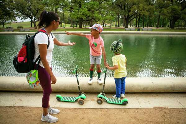 Brenda Armstrong brings her two children, Zach, 5, and Parker, 3, to play at the park, Friday, March 13, 2020, at Hermann Park in Houston. Armstrong works as a contractor in schools and is currently waiting for work to resume.
