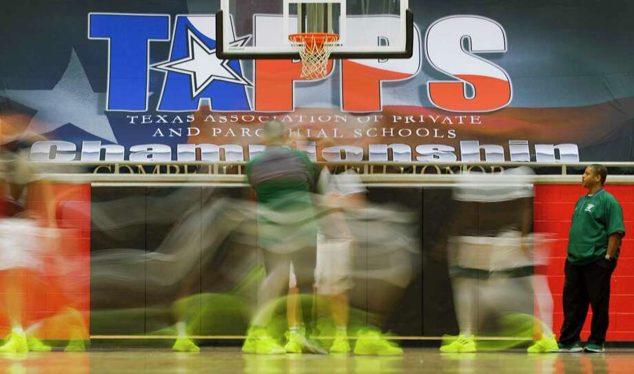Players with The Woodlands Christian Academy warm up before the TAPPS 4A state championship game at West High School, Friday, March 1, 2019, in West. Photo: Jason Fochtman, Houston Chronicle / Staff Photographer / © 2019 Houston Chronicle