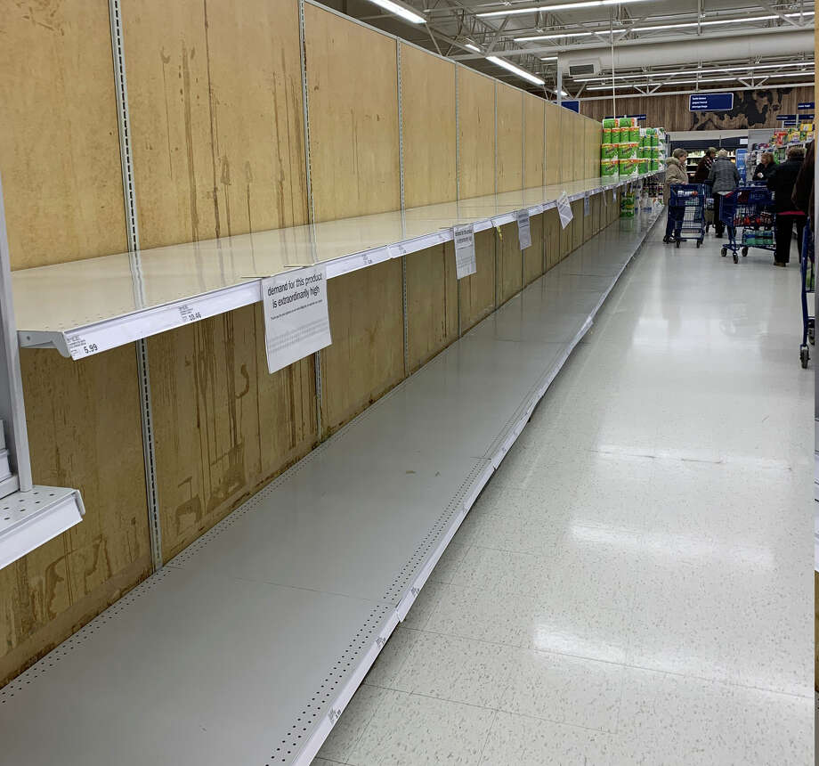 The shelves at Meijer and Walmart were cleared of toilet paper and paper towels Friday as shoppers looked to stock up in case of a quarentine. Photo: Cathie Crew/Pioneer Photo