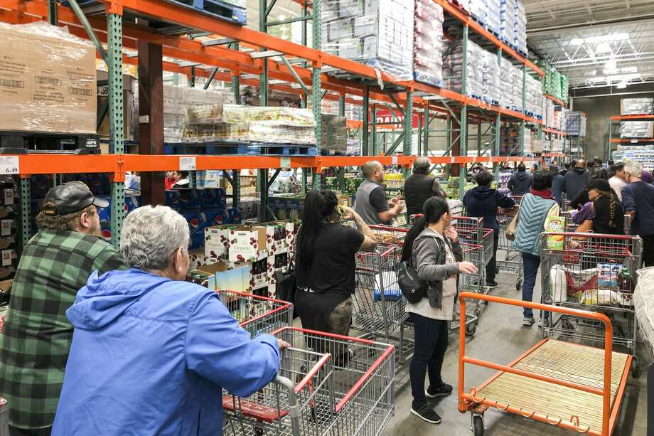 Shoppers in line for bottled water, toilet paper and paper towels at Costco in Vallejo, Friday, March 13, 2020. Photo: Chris Preovolos