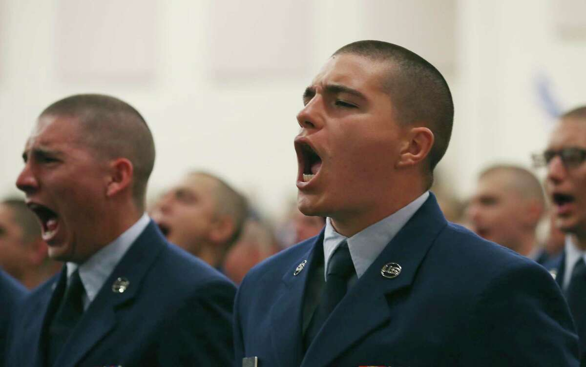 U.S. Air Force airmen participate in a basic training graduation ceremony held indoors for the first time at Joint Base San Antonio-Lackland on March 13 due to concerns about COVID-19.