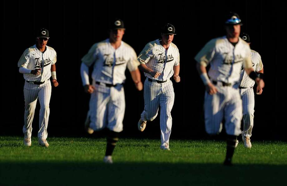 Conroe players warm up before a high school baseball game against The Heights during the Ferrell Classic at Conroe High School, Thursday, March 5, 2020, in Conroe. Photo: Jason Fochtman, Houston Chronicle / Staff Photographer / Houston Chronicle  © 2020