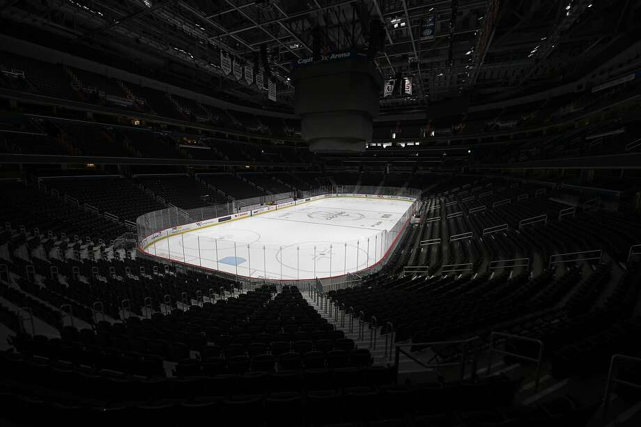 NHL arenas such as the one in Washington that is home to the Capitals will be empty for awhile. To award a Stanley Cup, the league might have to get creative. Photo: Nick Wass / Associated Press