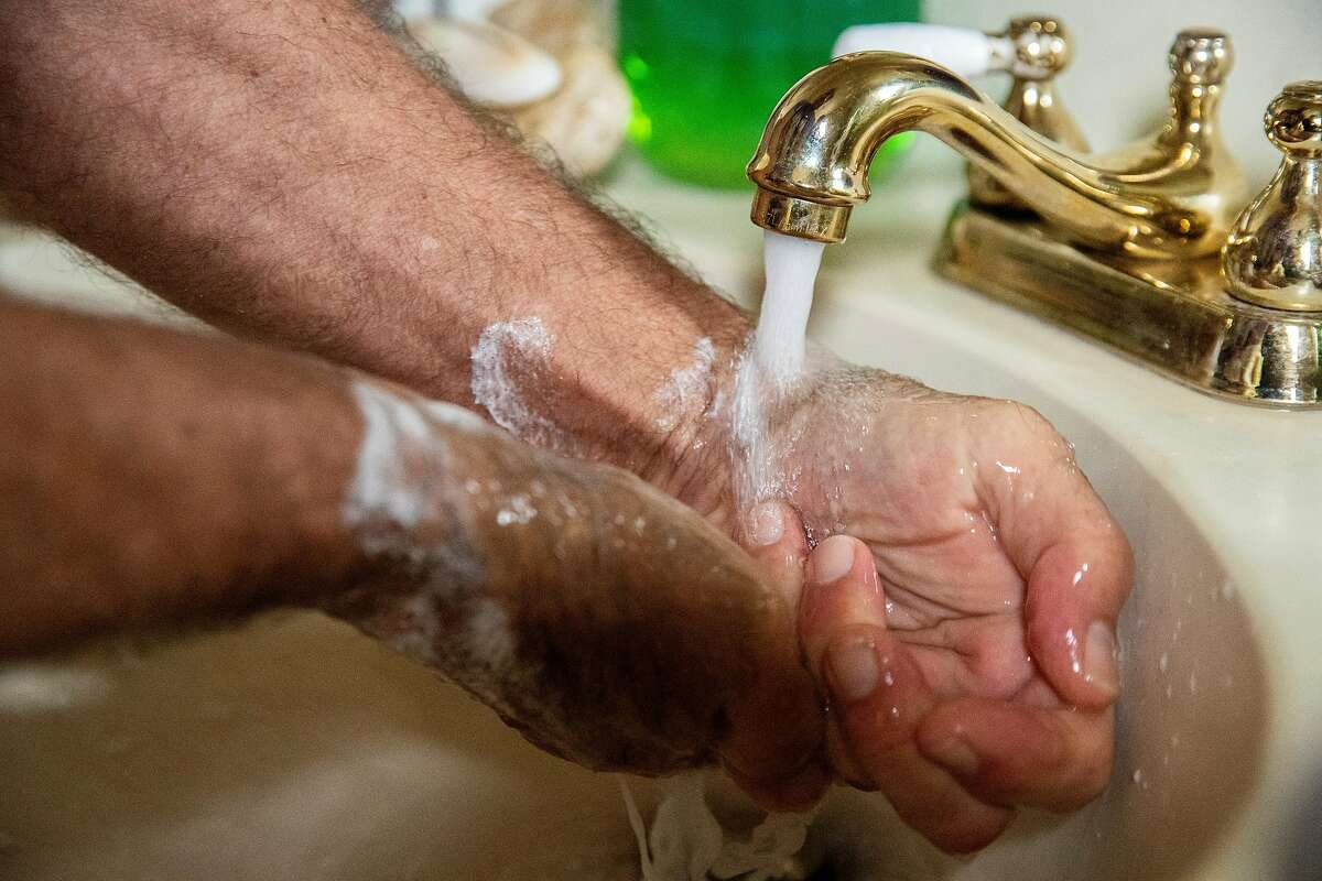 David Stahlberg washes his hands at home on Friday, March 13, 2020, in Cotati, Calif. Stahlberg returned from Italy with his wife. His wife became ill with what her doctor thinks is COVID-19. Stahlberg washes his hands dozens of times a day.