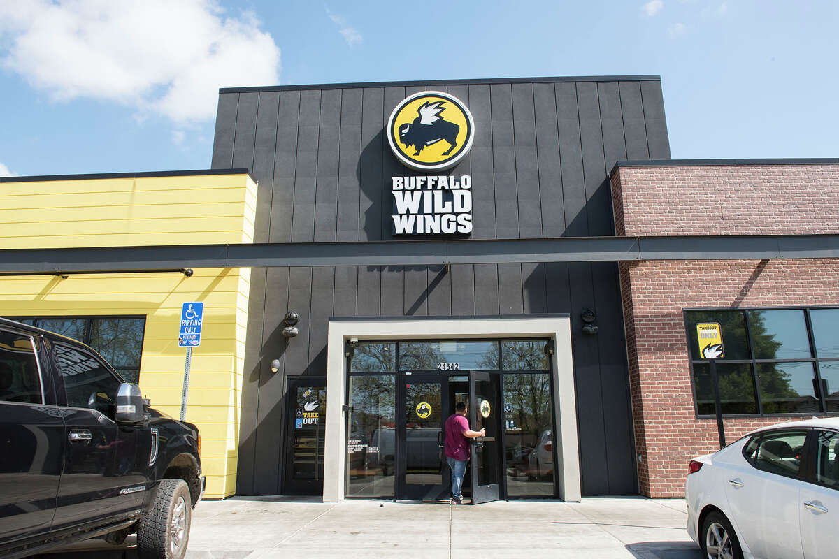 The exterior of a Buffalo Wild Wings in Haward, Calif. the day after the NBA, NHL, MLB, MLS and NCAA either suspended or outright cancelled their seasons due to the spread of the coronavirus, which is now a global pandemic according to the World Health Organization.