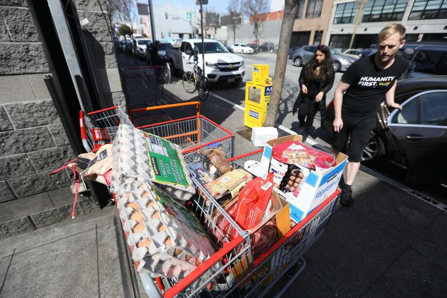 Shoppers leave Costco in San Francisco, Friday, March 13, 2020. Photo: Douglas Zimmerman/SFGATE