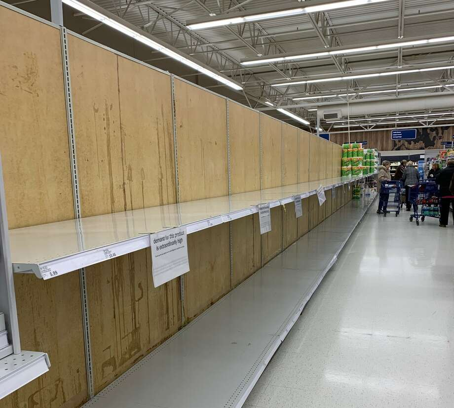 Local stores were selling out of toilet paper and disinfectant products, as well as other items Friday as shoppers prepared for a possible extended quarantine due to the coronavirus. Photo: Pioneer Photo/Cathie Crew