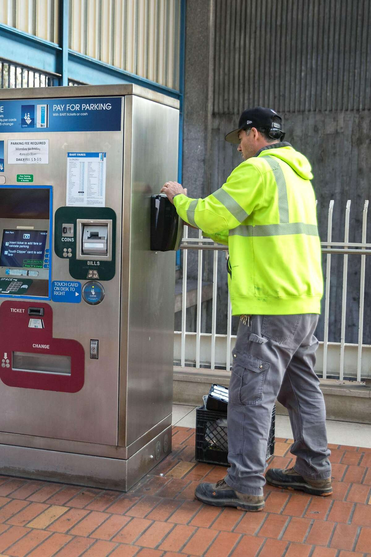 Lee Martin, plumber, installs hand sanitizer dispenser inside the BART facilities at Glen Park station. BART is losing up to $600,000 a day from dwindling ridership during the coronavirus outbreak, a crisis for an agency that relies on fares for 60 % of its operating costs. In addition to the losses, the transportation agency is chipping in thousands of dollars for extra cleanings, hand sanitizer dispensaries in all 48 stations, and other protections against the virus. On Friday, March 13, 2020. San Francisco, Calif.