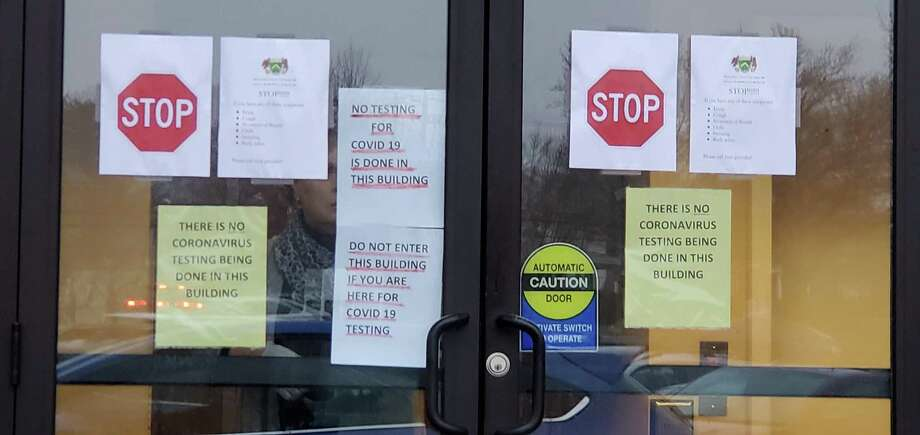 Signs on the building where a Fairfield man, who tutors Wilton students, tried to get a coronavirus test on March 12. Photo: Contributed Photo / / Wilton Bulletin Contributed