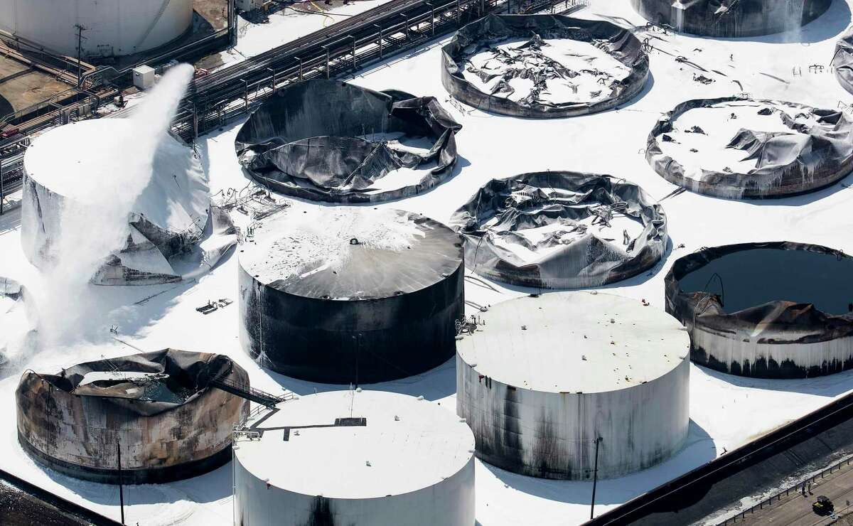 """Emergency crews doused what was left of the extinguished petrochemical tank fire at Intercontinental Terminals Company on Wednesday, March 20, 2019, in Deer Park. Fire crews extinguished the blaze at ITC about 3 a.m., Wednesday, almost four days after it started, which caused a plume of black smoke to linger over the Houston area. ITC officials said the cause of the fire is still unknown. EPA on-site coordinator Adam Adams said they have been in Deer Park since Sunday, conducting air monitoring at ground level and in the plume. Biggest concerns are """"volatile organic chemicals"""" and particulates, Adams said. He added that no hazardous levels have been detected."""