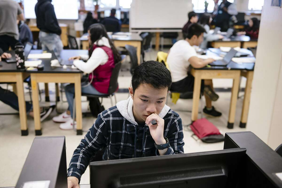 Student Kevin Nie works on a computer to research the coronavirus during Mr. Mundahl's 11th grade Health Sciences class at the Phillip Burton Academic School in San Francisco, California, US, on Friday, March 13, 2020. The San Francisco Unified School District announced it would close schools for three weeks amid coronavirus concern starting on Monday, March 16th.