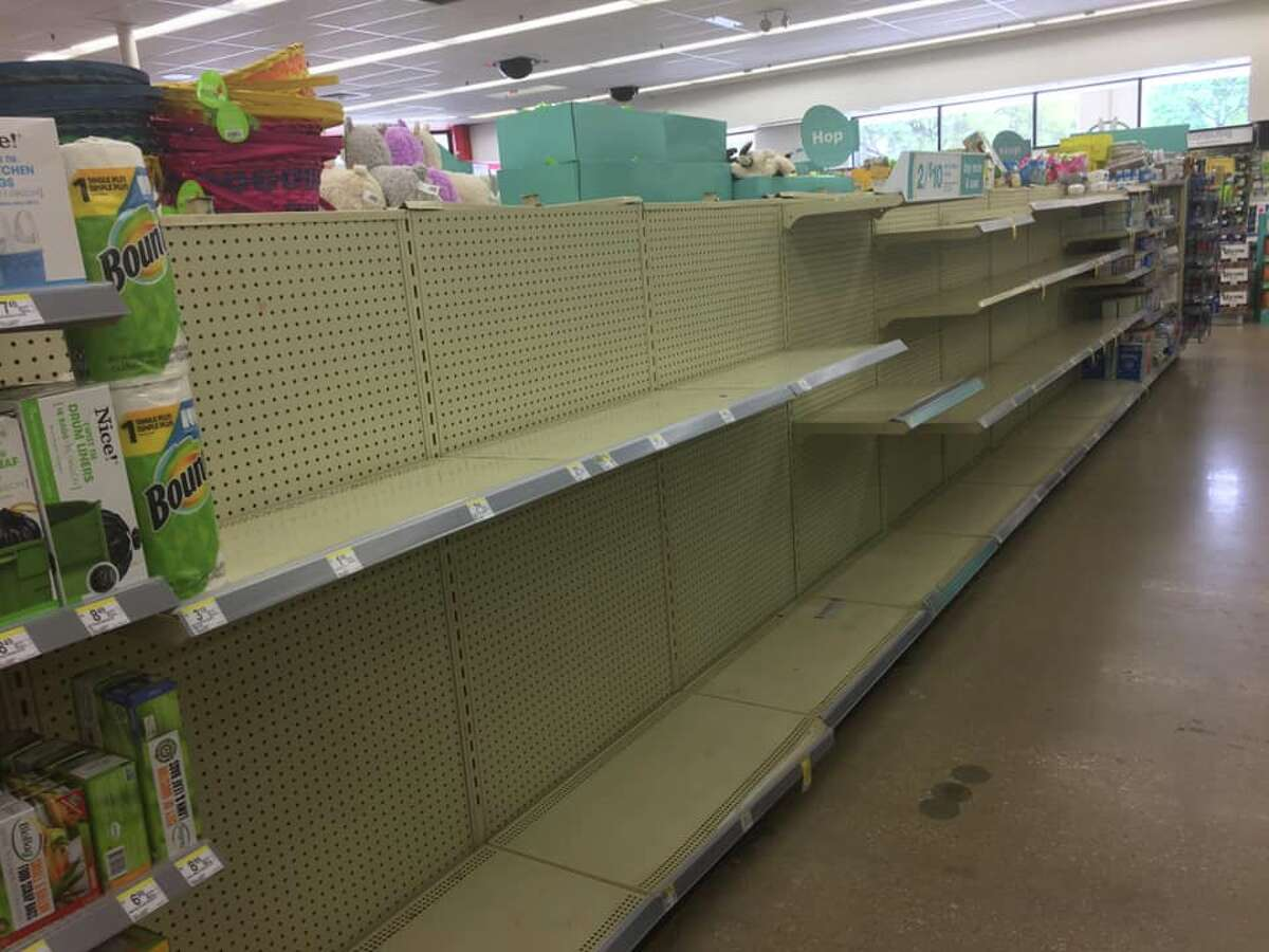 Photos from readers show the impact on Houston-area grocery and big-box stores, as shoppers waited in long lines and emptied shelves after news of local coronavirus cases broke.