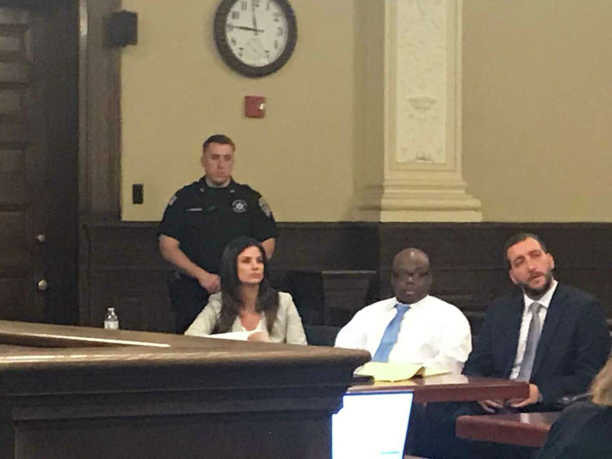 Law clerk Terry D'Aloia, defendant James White and defense attorney Kurt Haas listen as Assistant District Attorney Cheryl McDermott delivers her opening statement duringWhite's quadruple homicide trial in Rensselaer County Court on Friday, March 13, 2020.