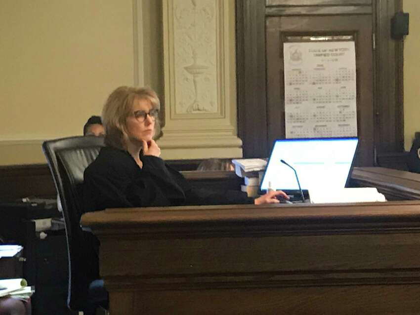 Rensselaer County Court Judge Debra Young listens to openings during the murder trial of James White in Troy, N.Y. on Friday March 13, 2020.