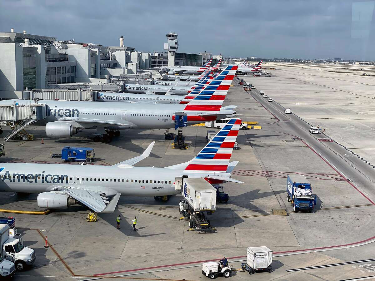 In this file photo taken on March 03, 2020 American Airlines planes are seen at Miami International Airport (MIA) in Miami, Florida.