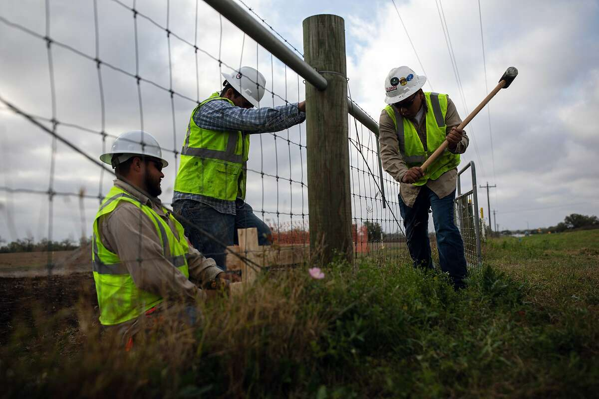 A crew works on a pipeline construction project in Karnes County, Texas, March 12, 2020.