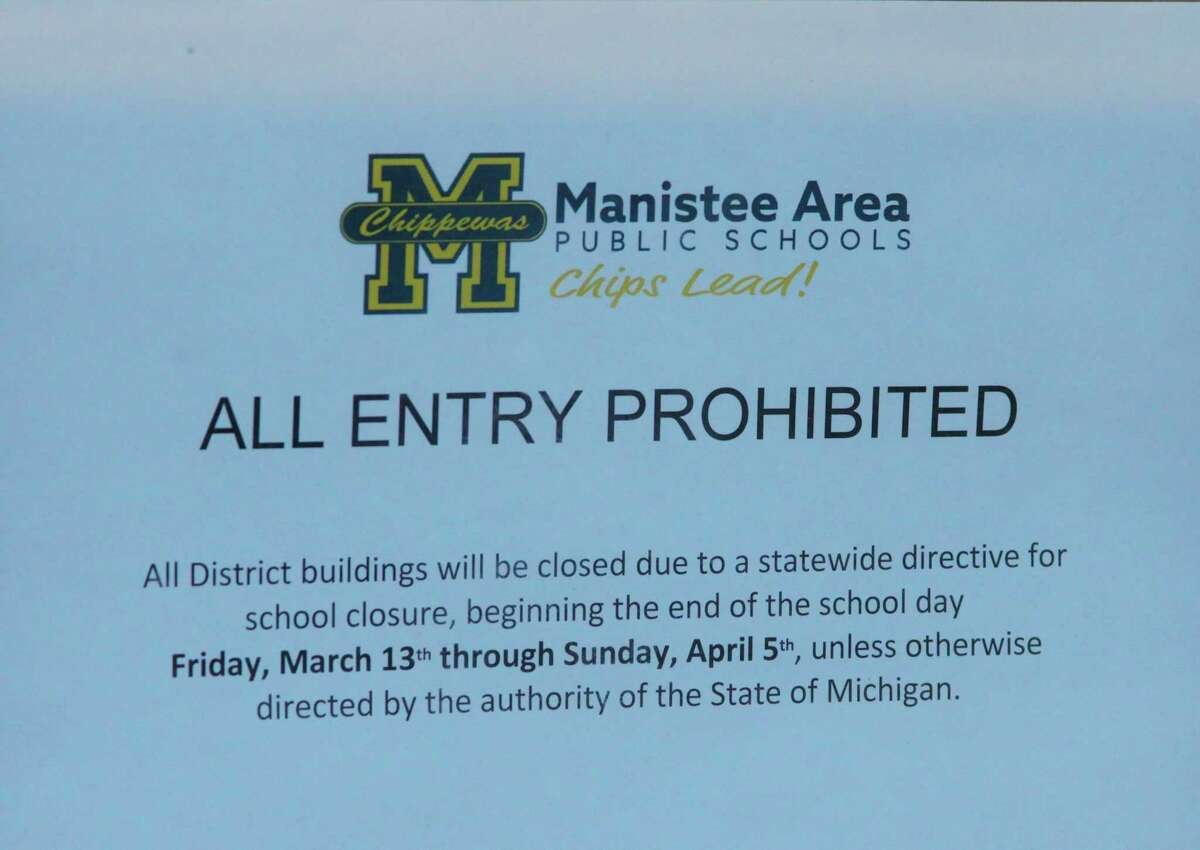 Signs like the one shown adorn all the doorways to the Manistee Area Public Schools after Gov. Gretchen Whitmer closed all Michigan schools on Friday due to the coronavirus. (Ken Grabowski/News Advocate)