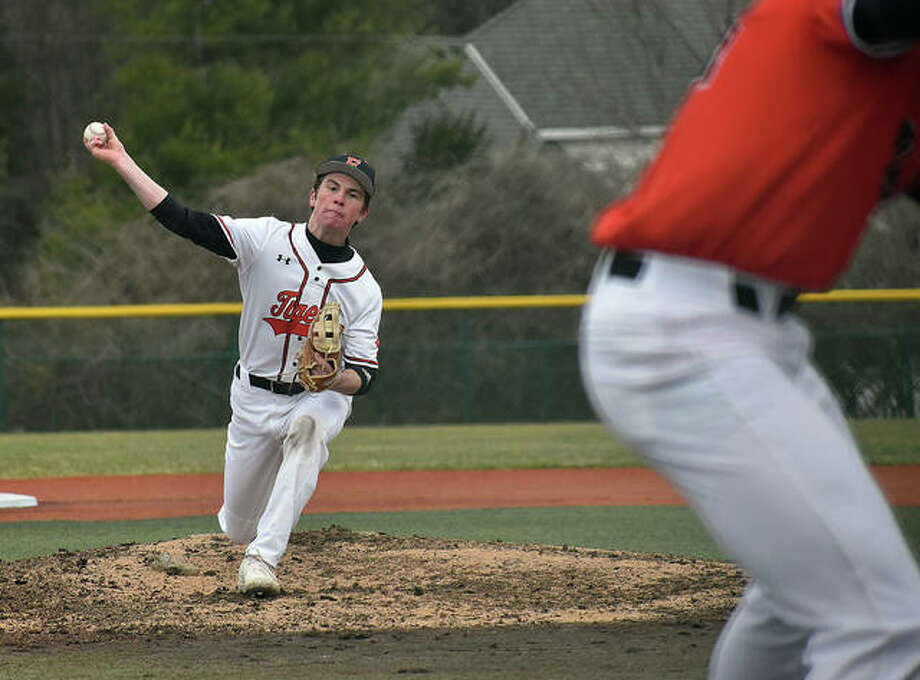 Edwardsville pitcher Evan Funkhouser delivers a pitch to a hitter during an intrasquad game on Friday on the JV turf field inside the District 7 Sports Complex.