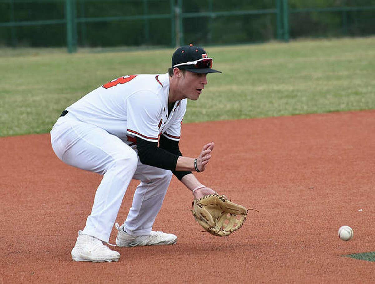 Edwardsville third baseman Drake Westcott fields a ground ball during an intrasquad game.