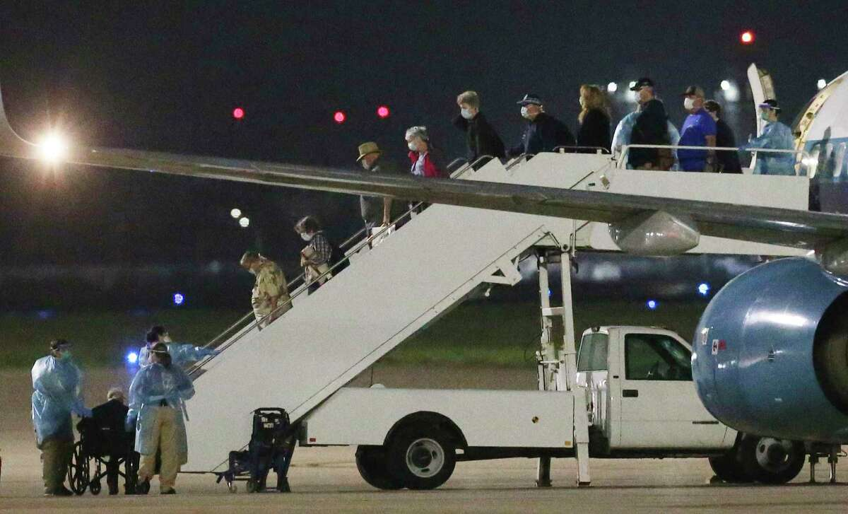 Passengers evacuated from the Grand Princess cruise ship arrive at Joint Base San Antonio-Lackland on March 12. Military City, USA, responded to this call for help with compassion and professionalism.