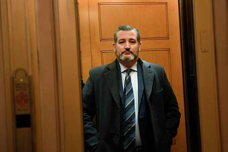 In this Feb. 5, 2020, file photo Sen. Ted Cruz, R-Texas, stands in an elevator on Capitol Hill in Washington. Cruz isolated himself after determining he had contact with a person at a Maryland political conference who got COVID-19.